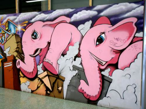 Pink elephants racing through the mall