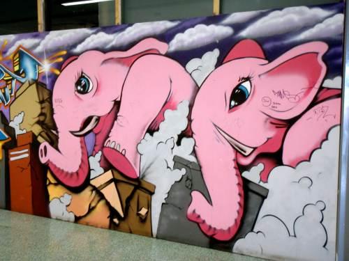 Pink elephants racing through the mall