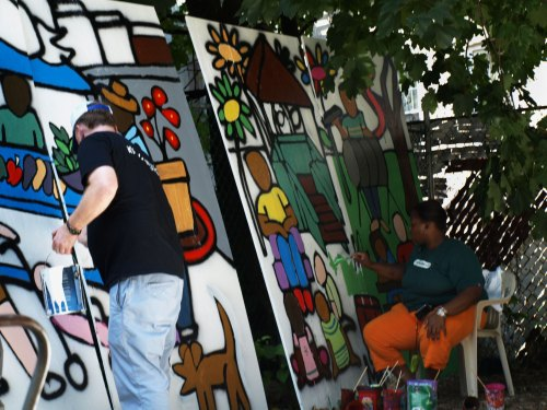 Volunteers Painting Mural for Market