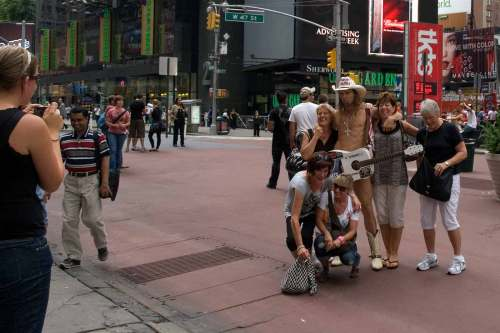 Naked Cowboy with friends on Times Square