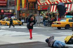 Girl in bowler being photographed in Times Square