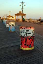 Painted garbage cans on boardwalk Coney Island